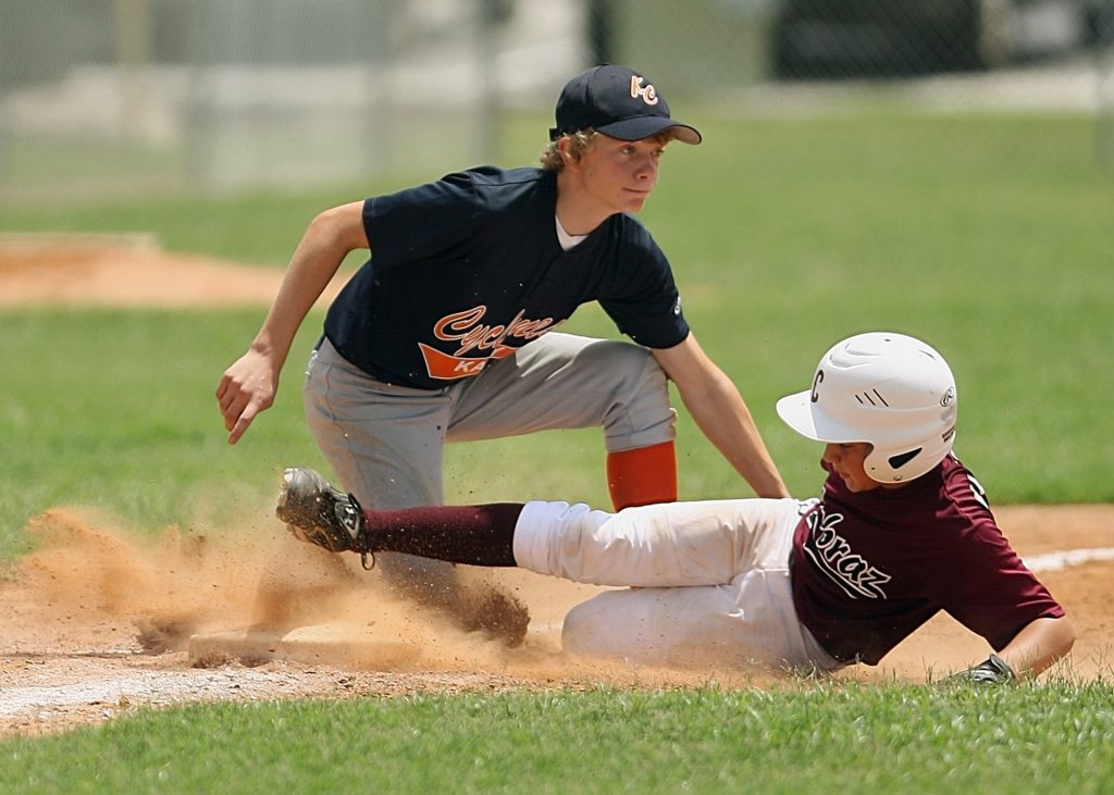 baseball 2 players 1 sliding 1 defending