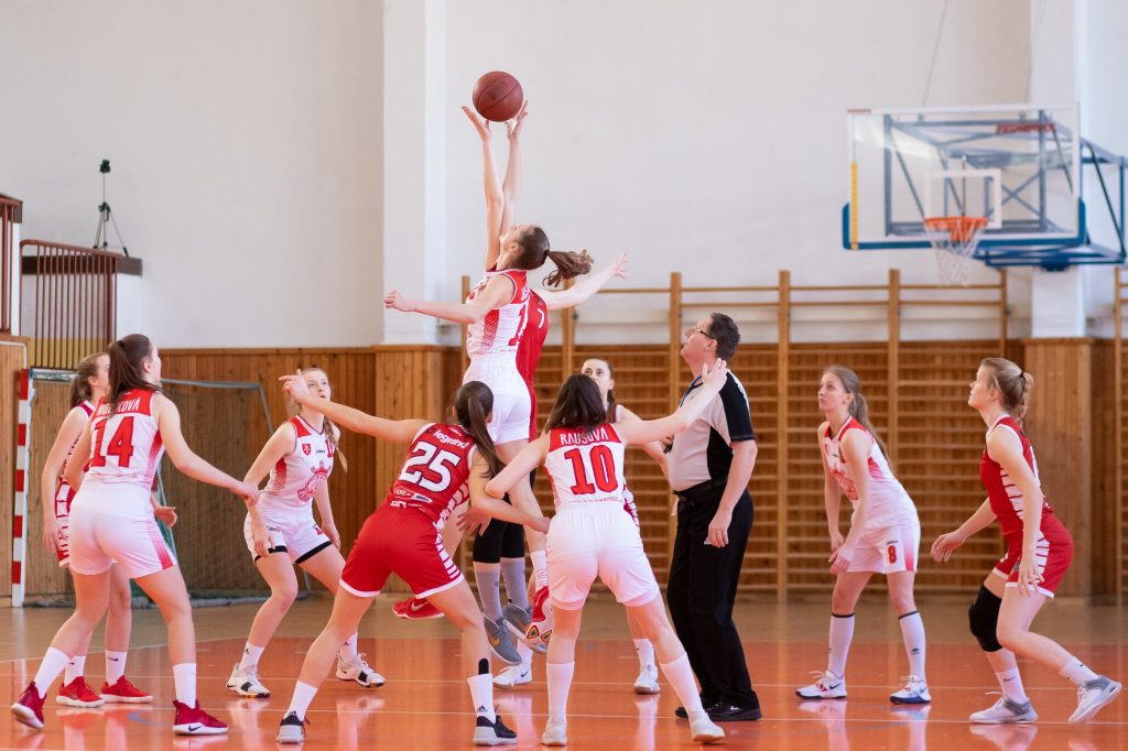 women playing basketball at middle school level ball in air manage your league